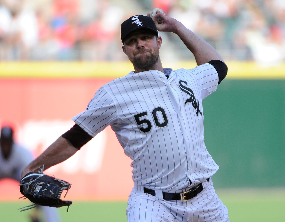 . Chicago White Sox starting pitcher John Danks (50) throws against the Detroit Tigers during the first inning of a baseball game, Saturday, June 6, 2015 in Chicago.  (AP Photo/David Banks)
