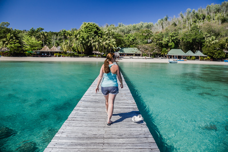 Lina Stock of Divergent Travelers walking to Turtle Island in Fiji.