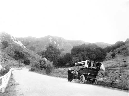 . An automobile on a mountain road, on its way to the official opening of the L.A. aqueduct at the northern end of the San Fernando Valley on November 5, 1913.   (DWP)