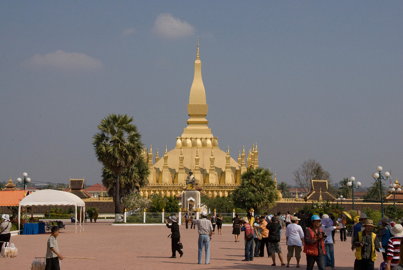 Tourits outside the Prathat Luang Temple in Vientiane, Laos