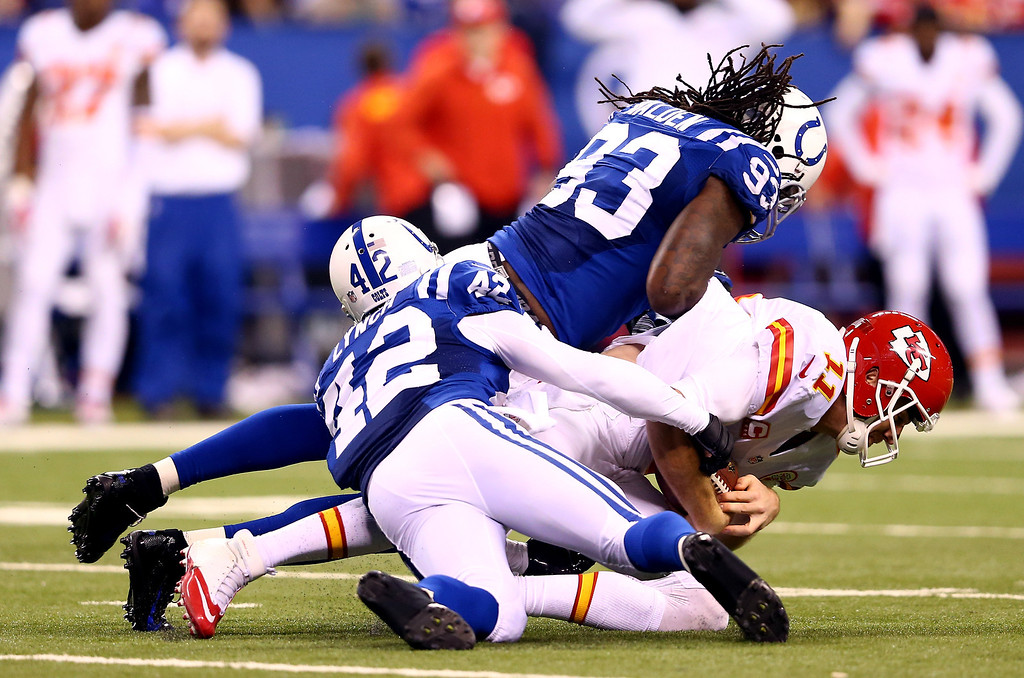 . INDIANAPOLIS, IN - JANUARY 04: Quarterback Alex Smith #11 of the Kansas City Chiefs is tackled by outside linebacker Erik Walden #93 and defensive back Corey Lynch #42 of the Indianapolis Colts during a Wild Card Playoff game at Lucas Oil Stadium on January 4, 2014 in Indianapolis, Indiana.  (Photo by Andy Lyons/Getty Images)