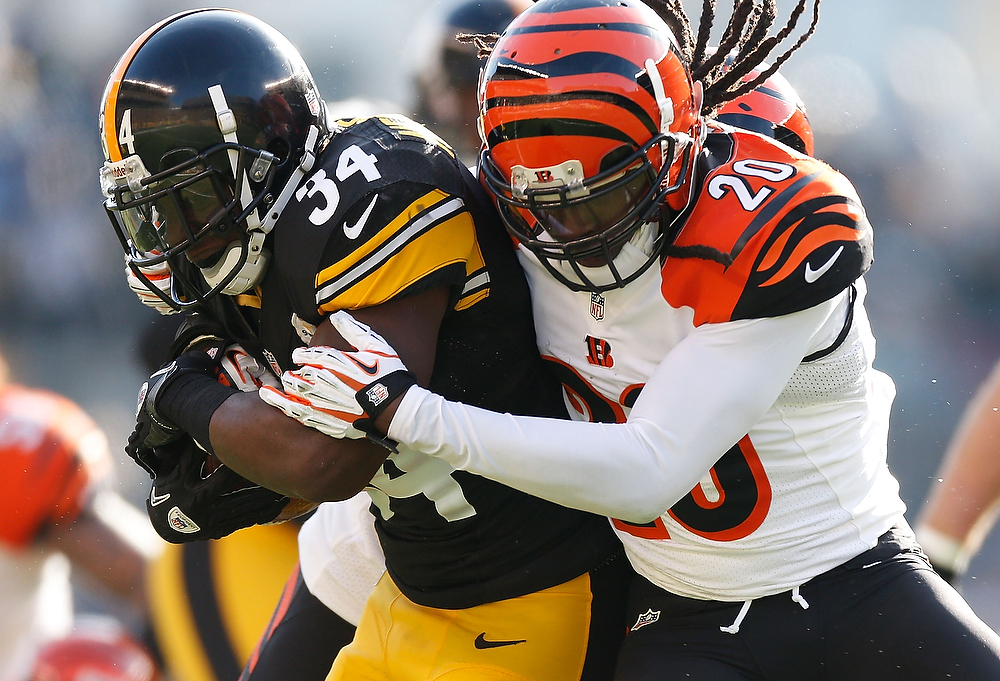 Description of . Rashard Mendenhall #34 of the Pittsburgh Steelers is tackled during a second quarter run by Reggie Nelson #20 of the Cincinnati Bengals at Heinz Field on December 23, 2012 in Pittsburgh, Pennsylvania. (Photo by Gregory Shamus/Getty Images)