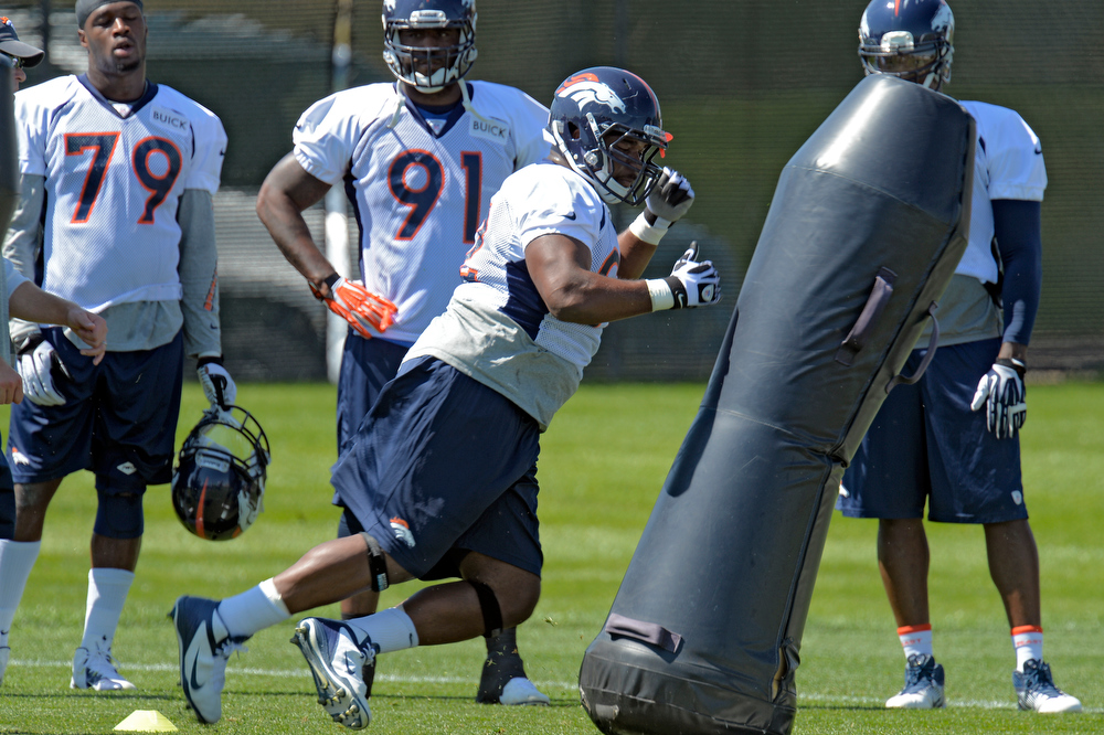 . Denver Broncos defensive tackle Sylvester Williams (92) hits the dummy during practice August 19, 2013 at Dove Valley (Photo by John Leyba/The Denver Post)