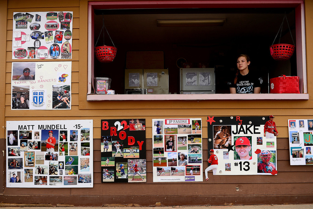 . PARKER, CO - APRIL 29: Kelsey Thaxton works the concessions stand  during Regis Jesuit\'s final home game. The stand is adorned with poster boards honoring the team\'s class of seniors. Among the group is Brody Weiss (22), son of Colorado Rockies manager Walt Weiss. (Photo by AAron Ontiveroz/The Denver Post)