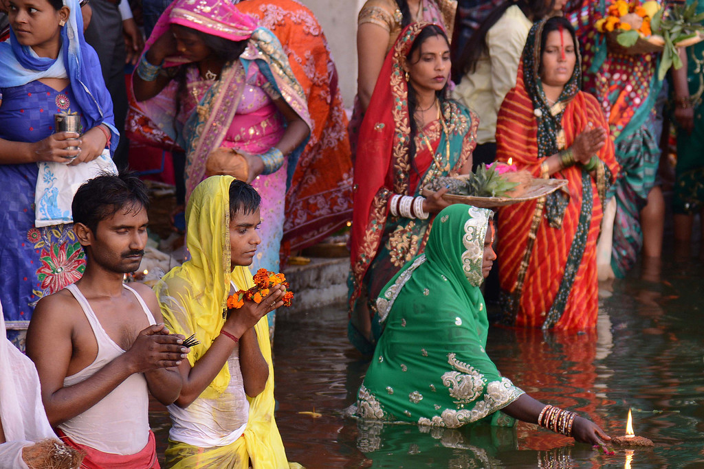 . Indian Hindu devotees offer prayers during the \'Chhat Puja \'while standing in the sarover (water tank) of the Durgiana temple in Amritsar on November 8, 2013.    AFP PHOTO /NARINDER NANU/AFP/Getty Images