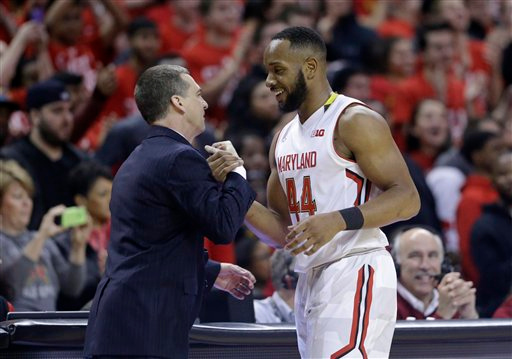 . Maryland guard/forward Dez Wells, right, embraces Maryland head coach Mark Turgeon in the final moments of an NCAA college basketball game against Michigan, Saturday, Feb. 28, 2015, in College Park, Md. (AP Photo/Patrick Semansky)