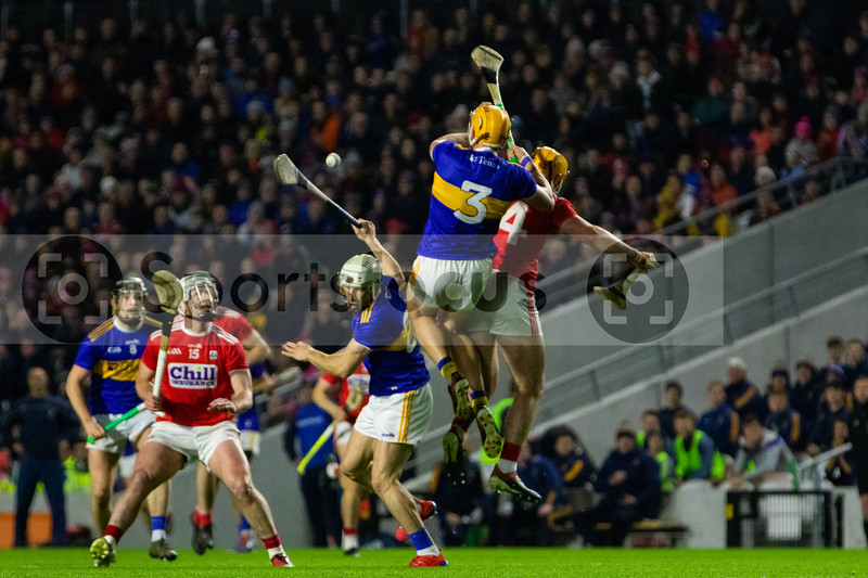 Tipperary's Ronan Maher wins the ball over Cork's Declan Dalton