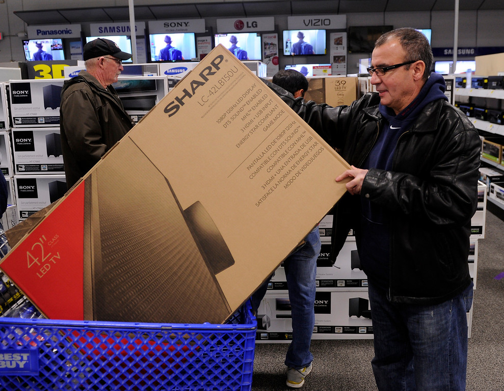 . Said Baya put a pair of televisions into his shopping cart Thursday night, November 28, 2013 at the Best Buy store in Lone Tree. Many metro area stores got a jump on Black Friday by opening on Thursday. Photo By Karl Gehring/The Denver Post