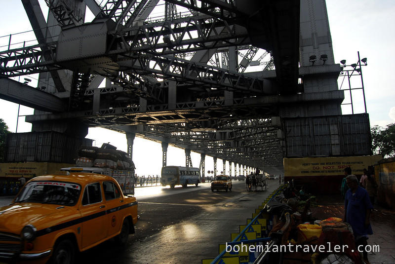 cab crossing Howrah Bridge.jpg