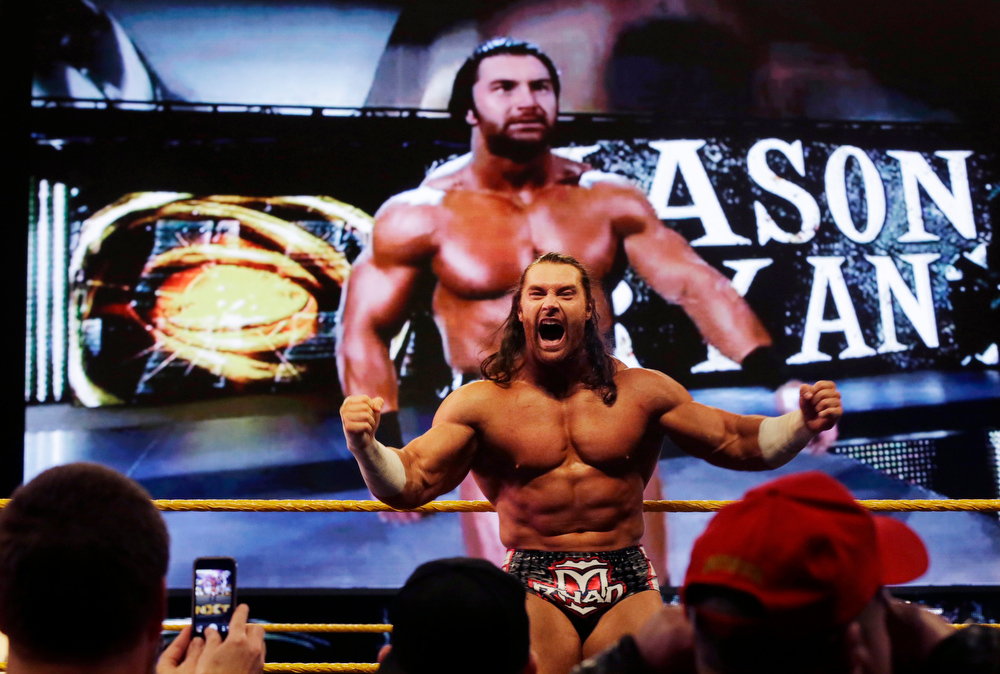 Description of . Professional wrestler Mason Ryan celebrates his win over Percy Watson at Wrestlemania Axxess event Saturday, April 6, 2013, in East Rutherford, N.J., ahead of Sunday's Wrestlemania at MetLife stadium. (AP Photo/Mel Evans)