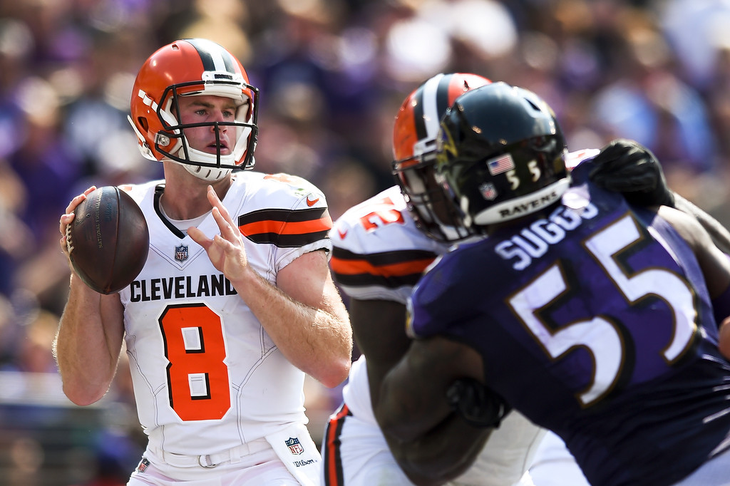 . Cleveland Browns quarterback Kevin Hogan (8) looks for an open man during the first half of an NFL football game against the Baltimore Ravens in Baltimore, Sunday, Sept. 17, 2017. (AP Photo/Gail Burton)