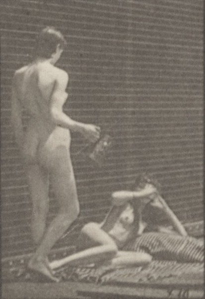 Nude woman standing and filling a goblet and the other drinks while lying on the ground