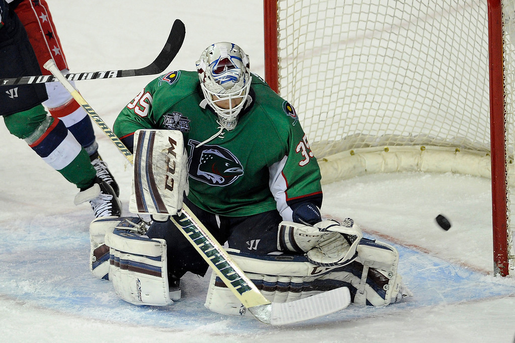. DENVER, CO - MAY 2: Denver Cutthroats goalie Kent Patterson (35) blocks a shot during the second period of game 1 of the Ray Miron Presidents Cup Finals at the Denver Coliseum in Denver, Colorado on May 2, 2014. (Photo by Seth McConnell/The Denver Post)