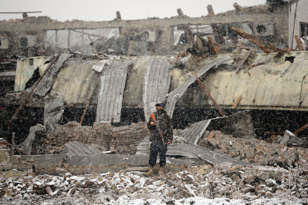 Description of . An Afghanistan policeman stands guard at the site of an explosion in Kabul on December 17, 2012. A car bomb exploded at a compound owned by a US-based construction company under contract to the Afghan army, killing at least one person and wounding 15, police said. Five foreigners including some from the US and South Africa were among the wounded, a security source at the company told AFP. MASSOUD HOSSAINI/AFP/Getty Images