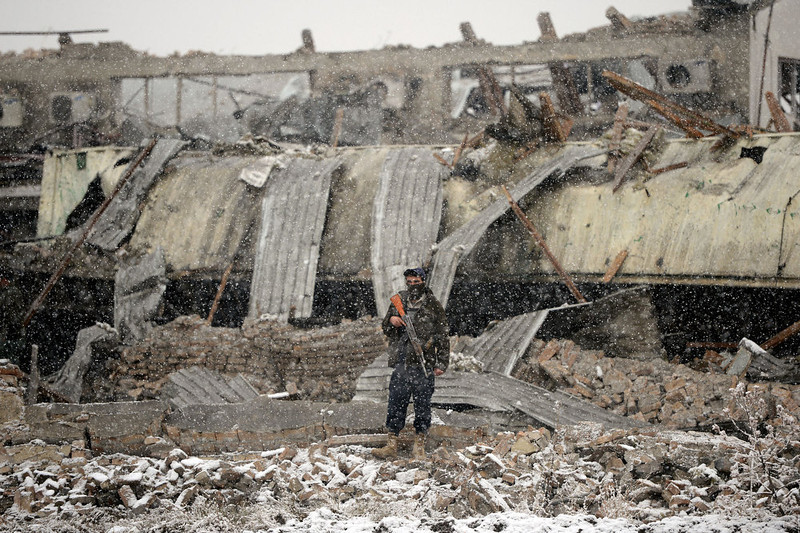 . An Afghanistan policeman stands guard at the site of an explosion in Kabul on December 17, 2012. A car bomb exploded at a compound owned by a US-based construction company under contract to the Afghan army, killing at least one person and wounding 15, police said. Five foreigners including some from the US and South Africa were among the wounded, a security source at the company told AFP. MASSOUD HOSSAINI/AFP/Getty Images