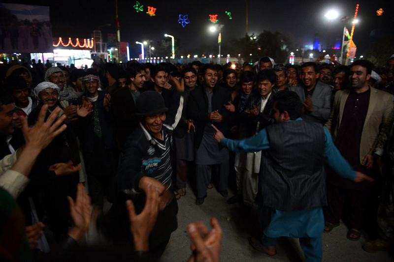 . Afghan men dance during celebrations on the first night of Nowruz, the Persian New Year, in Mazar-i Sharif, north of Afghanistan on March 21, 2013. Nowruz, one of the biggest festivals of the war-scarred nation, marks the first day of spring and the beginning of the year in the Persian calendar. Nowruz is calculated according to a solar calendar, this coming year marking 1392.  SHAH MARAI/AFP/Getty Images