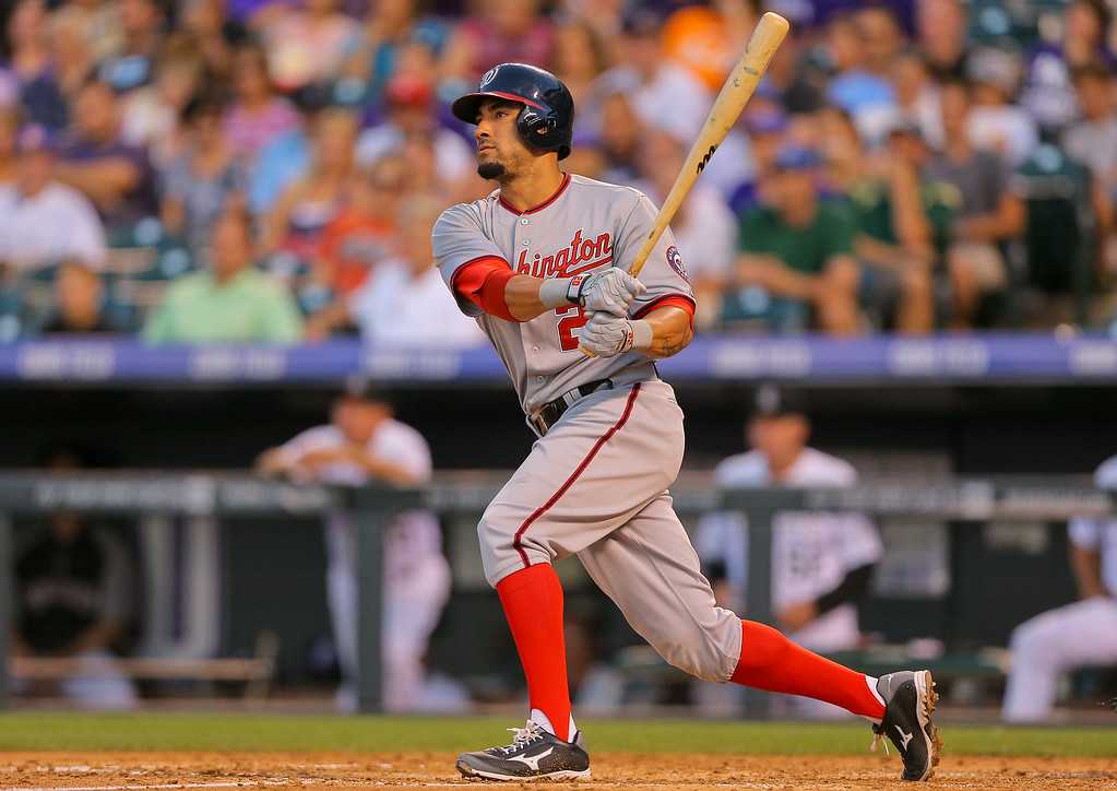 . DENVER, CO - JULY 22:  Ian Desmond #20 of the Washington Nationals watches his double during the fifth inning against the Colorado Rockies at Coors Field on July 22, 2014 in Denver, Colorado. Desmond went on to score in the inning. (Photo by Justin Edmonds/Getty Images)