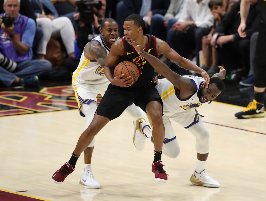 . Golden State Warriors forward Draymond Green (23), right, and forward Andre Iguodala (9) defends Cleveland Cavaliers guard Rodney Hood (1) in the second half of Game 3 of basketball\'s NBA Finals, Wednesday, June 6, 2018, in Cleveland. The Warriors defeated the Cavaliers 110-102 to take a 3-0 lead in the series. (AP Photo/Carlos Osorio)