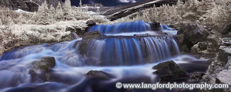 An infrared panorama of one of the many waterfalls along the West side of Going to the Sun road. You'll need a wide angle lens to shoot the falls, as you end up being pretty close to them.