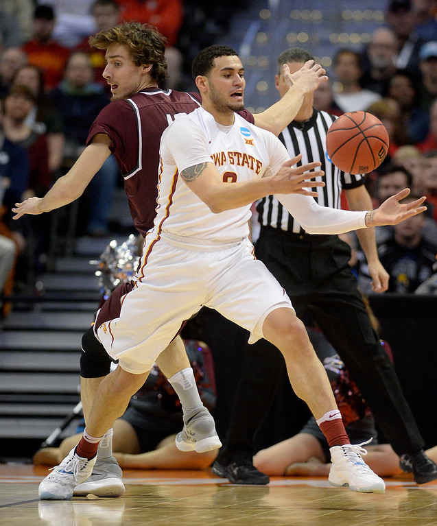 . DENVER, CO - MARCH 19: Abdel Nader (2) of the Iowa State Cyclones bobbles the ball as Lis Shoshi (12) of the Arkansas Little Rock Trojans defends during the first half of their second round NCAA Tournament game on Saturday, March 19, 2016. (Photo by AAron Ontiveroz/The Denver Post)