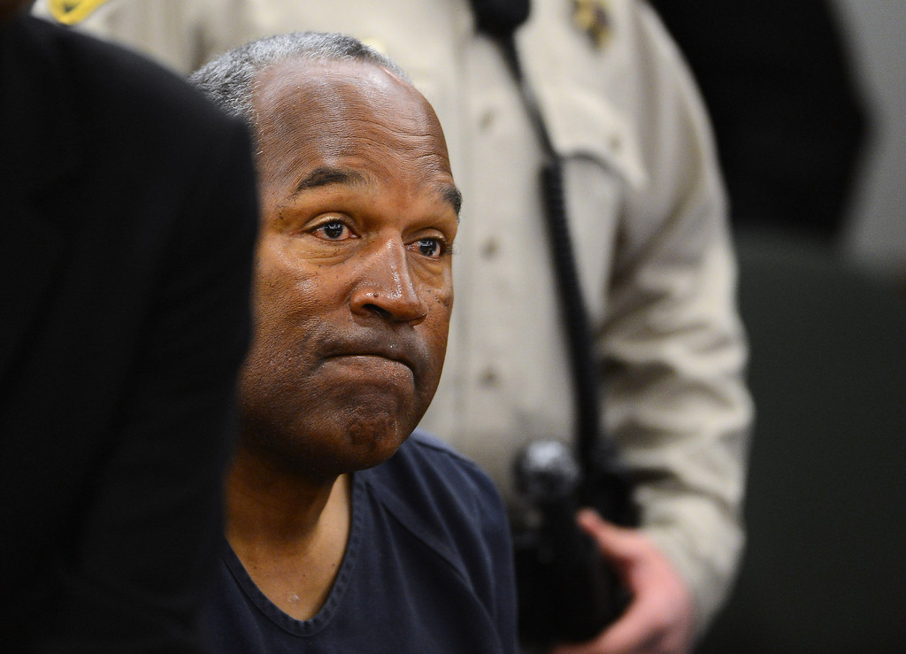 . O. J. Simpson appears during a break on the second day of an evidentiary hearing for Simpson in Clark County District Court, Tuesday, May 14, 2013 in Las Vegas.  The hearing is aimed at proving Simpson\'s trial lawyer, Yale Galanter,  had conflicted interests and shouldn\'t have handled Simpson\'s case. Simpson is serving nine to 33 years in prison for his 2008 conviction in the armed robbery of two sports memorabilia dealers in a Las Vegas hotel room.  (AP Photo/Ethan Miller, Pool)