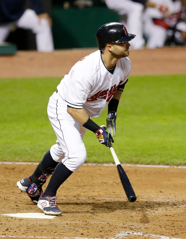 . Cleveland Indians\' Nick Swisher hits an RBI-single off Detroit Tigers starting pitcher Drew Smyly in the fifth inning of a baseball game, Monday, May 19, 2014, in Cleveland. Ryan Raburn scored. (AP Photo/Tony Dejak)