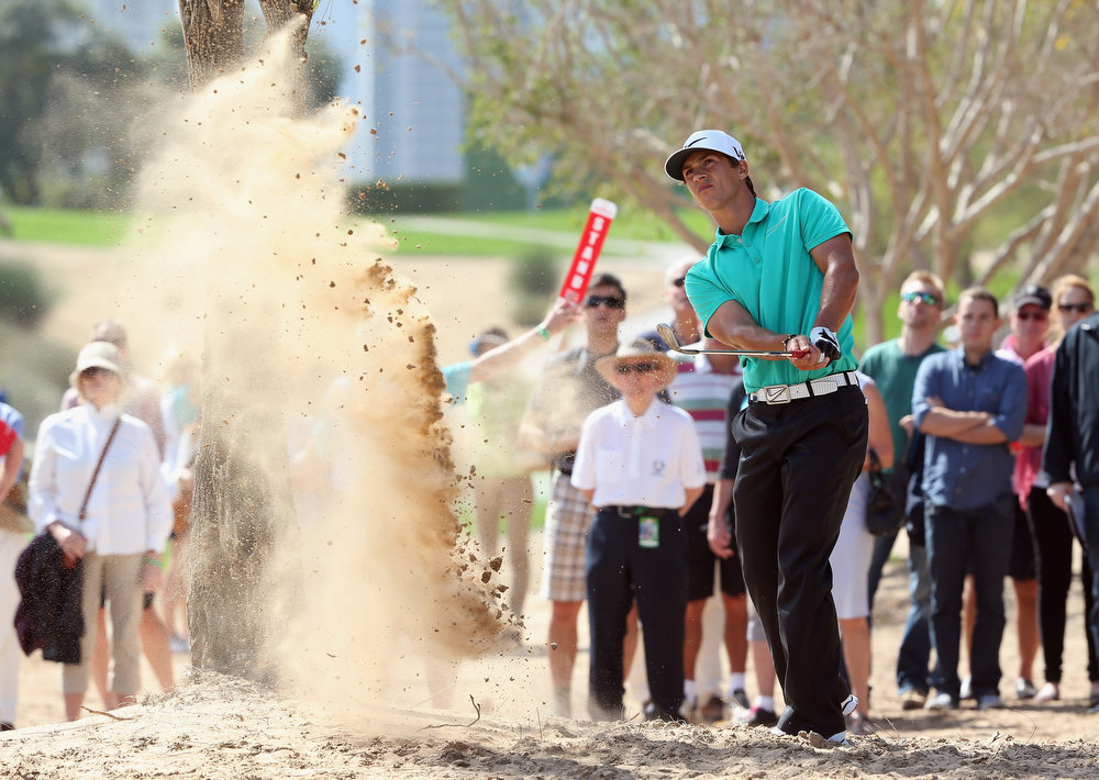 Description of . Thorbjorn Olesen of Denmark plays his second shot on the second hole during the final round of the Omega Dubai Desert Classic at Emirates Golf Club on February 3, 2013 in Dubai, United Arab Emirates.  (Photo by Andrew Redington/Getty Images)