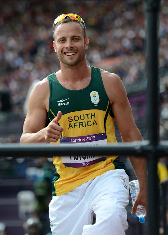 . South Africa\'s Oscar Pistorius gives a thumbs up before talking to the media in the mix-zone following his Men\'s 400m heat at the Olympic Stadium for the London 2012 Olympics in London, England on Saturday, Aug. 4, 2012.  (Nhat V. Meyer/Mercury News)