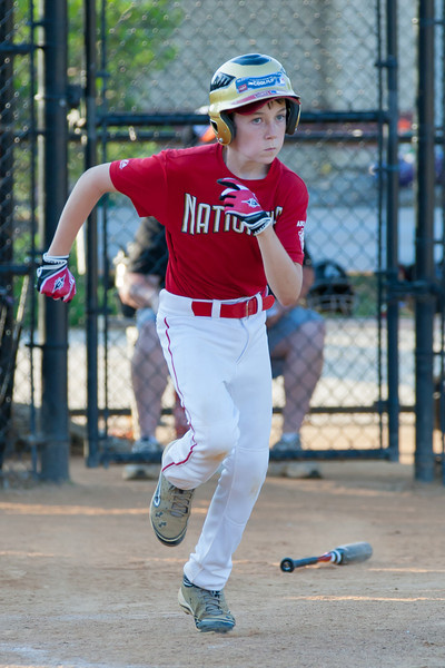 Toby hits a RBI single up the middle to extend the Nats lead to 3-1 in the top of the 6th inning. The Nationals played a close game against the Orioles before pulling away in the top of the 6th inning for a 5-2 win. They finished the regular season with a 12-6 record. 2012 Arlington Little League Baseball, Majors Division. Nationals vs Orioles (09 Jun 2012) (Image taken by Patrick R. Kane on 09 Jun 2012 with Canon EOS-1D Mark III at ISO 800, f4.0, 1/800 sec and 245mm)