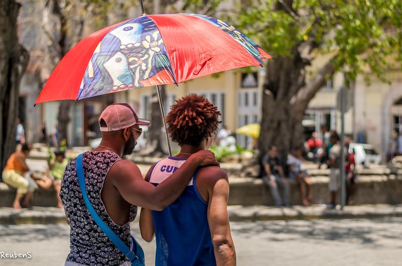 Friends sharing Umbrella Havanna.jpg