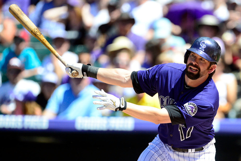 . Colorado Rockies first baseman Todd Helton (17) pokes a base hit off of San Diego Padres starting pitcher Clayton Richard (33) during the action in Denver. The Colorado Rockies hosted the San Diego Padres at Coors Field on Sunday, June 9, 2013. (Photo by AAron Ontiveroz/The Denver Post)