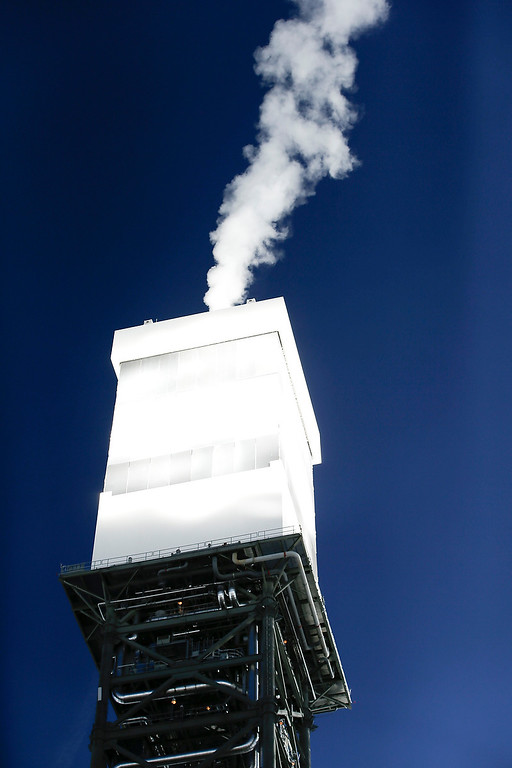 . A boilers that sit on 459-foot towers vents steam Tuesday, Feb. 11, 2014 in Primm, Nev. The Ivanpah Solar Electric Generating System, sprawling across roughly 5 square miles of federal land near the California-Nevada border. (AP Photo/Chris Carlson)