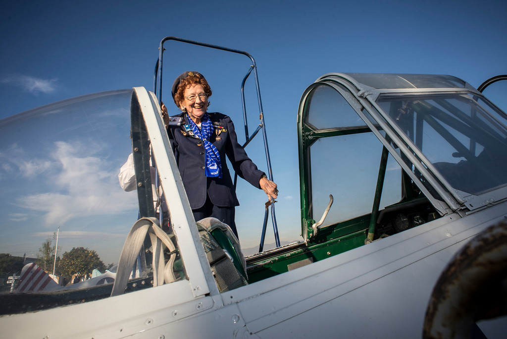 . Betty Strohfus, 94, of Nevada, a former WASP, climbs on board a vintage AT-6 airplane at Van Nuys airport Tuesday, December 30, 2013.  The Condor Squadron at the Van Nuys airport hosted the former WASP pilots who are in town to represent WASPS on a tournament of Roses float.  (Photo by David Crane/Los Angeles Daily News)