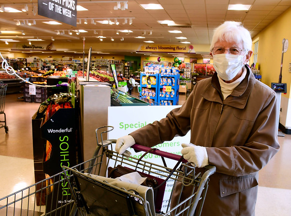 3/20/2020 Mike Orazzi | Staff Betty Fumiatti enters the Stop & Shop in Forestville while wearing a mask and rubber gloves under cloth gloves on Saturday morning.