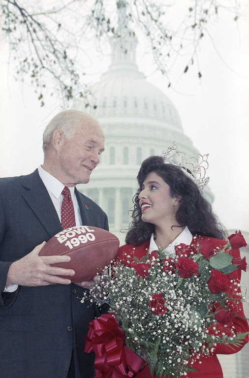 . Sen. John Glenn, D-Ohio poses with the 1990 Rose Bowl Queen, Yasmine Begum Delaware, as they visited Capitol Hill on Monday, Oct. 30, 1989 in Washington.   Glenn will serve as Grand Marshal of the 1990 Rose Bowl parade. (AP Photo/John Duricka)