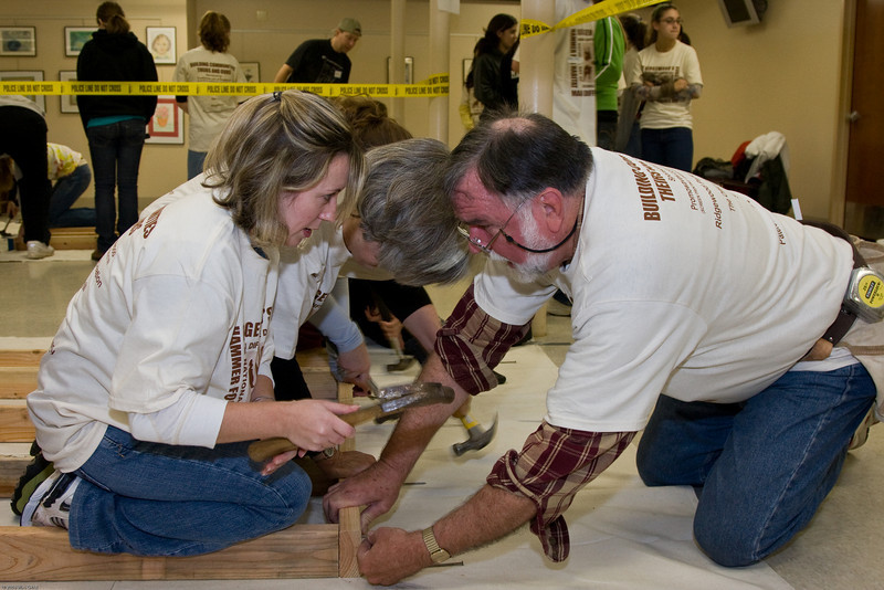 "1) Slug #: W 00017811; (2) Ridgewood, NJ; (3) 10/25/08; (4) Ridgewood ""Make A Difference Day"" Habitat for Humanity build; (5) (L-R) Gina Dunphy, Sherry Bennett and Rev. Stuart Smith of Habitat for Humanity collaborate during Make a Difference Day at the Ridgewood Community Center on 10/25/2008; (6) W.H. GRAE for the Ridgewood News."