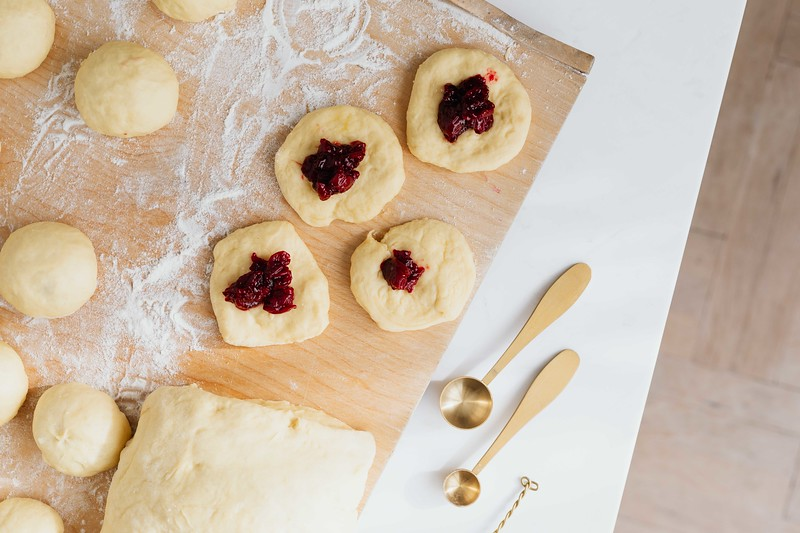 kaboompics_Adding cherry marmalade to Polish donuts - Paczki.jpg