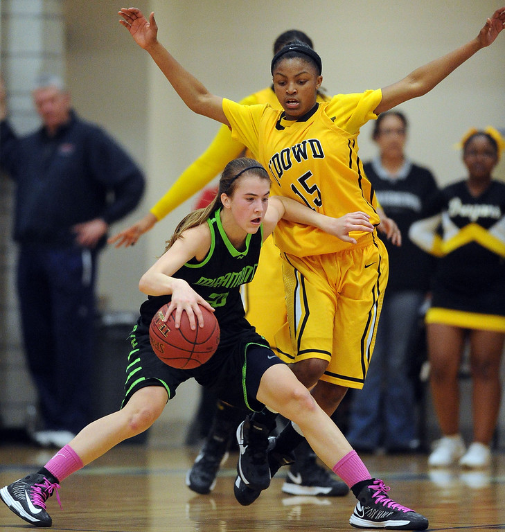 . Miramonte High\'s Sabrina Ionescu (20) left, tries to get past Bishop O\'Dowd High\'s Aisia Robertson (15) in the first period of their Division III North Coast Section basketball game in Dublin, Calif., on Saturday, March 2, 2013. Bishop O\'Dowd High went on to win the game 77-48. (Doug Duran/Staff)