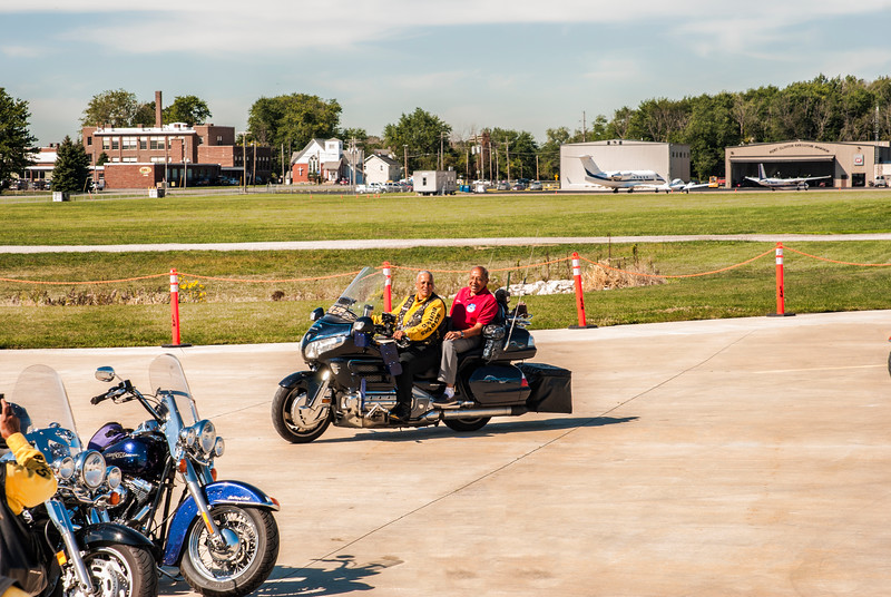 Dr. Harold Brown goes for a motorcyle ride with a member of the Buffalo Soldiers Motorcycle Club from Toledo at the Liberty Aviation Museum in Port Clinton, Ohio.