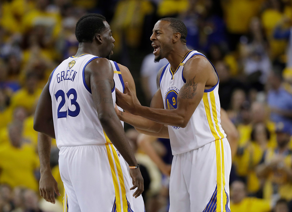 . Golden State Warriors forward Draymond Green (23) and forward Andre Iguodala (9) celebrate during the second half of Game 1 of basketball\'s NBA Finals against the Cleveland Cavaliers in Oakland, Calif., Thursday, June 1, 2017. (AP Photo/Marcio Jose Sanchez)