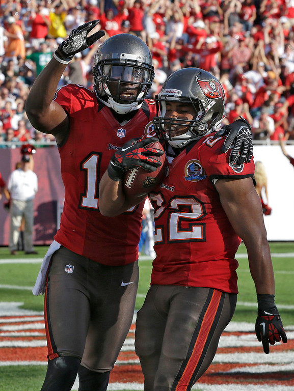 . Tampa Bay Buccaneers running back Doug Martin (22) celebrates with teammate wide receiver Tiquan Underwood after scoring against the Philadelphia Eagles during the fourth quarter of an NFL football game Sunday, Dec. 9, 2012, in Tampa, Fla. (AP Photo/Chris O\'Meara)