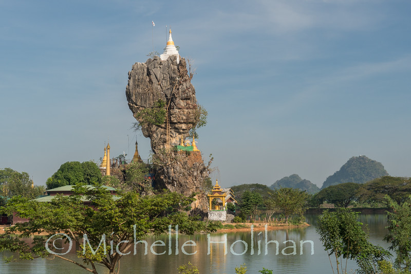 Rock formation topped with Kyaut Ka Latt Pagoda in  Hpa-An, Myanmar