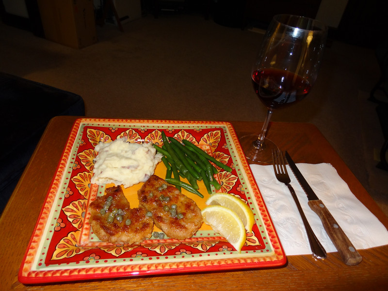 Pork schnitzel w/lemon caper butter, garlic mash potatoes and whole green beans.
