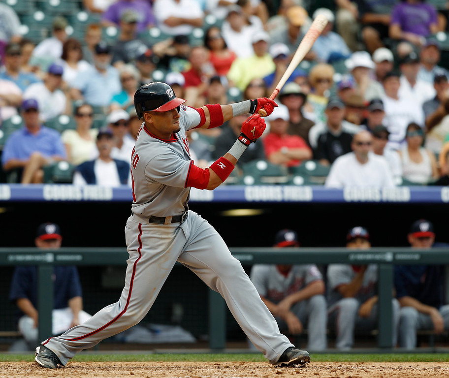 . Washington Nationals\' Ian Desmond follows the flight of his RBI-single against the Colorado Rockies in the eighth inning of the Nationals\' 5-4 victory in a baseball game in Denver, Thursday, June 13, 2013. (AP Photo/David Zalubowski)