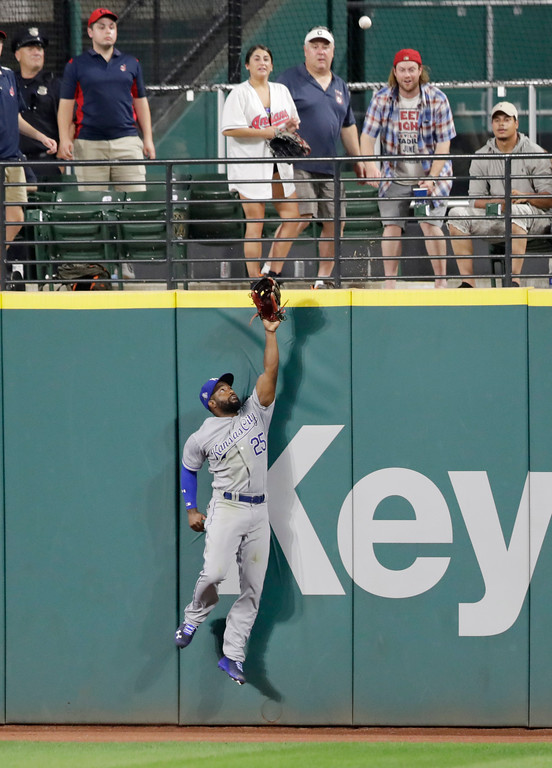 . Kansas City Royals\' Brian Goodwin jumps but can\'t reach a solo home run hit by Cleveland Indians\' Yandy Diaz in the fifth inning of a baseball game, Tuesday, Sept. 4, 2018, in Cleveland. (AP Photo/Tony Dejak)