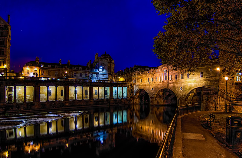 Pulteney Bridge - from the west side looking east - across the river Avon in Bath, England.