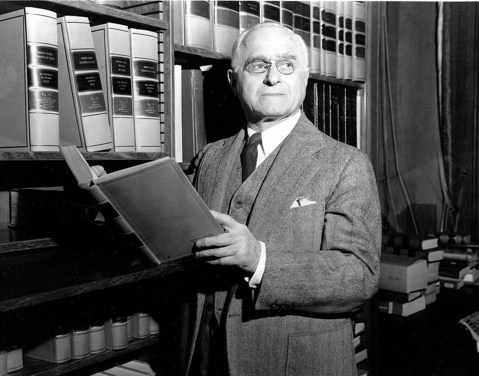 . U.S. Supreme Court Justice Felix Frankfurter poses with a book of statutes in his office in Washington, D.C., on Nov. 14, 1957, the eve of his 75th birthday.  (AP Photo)