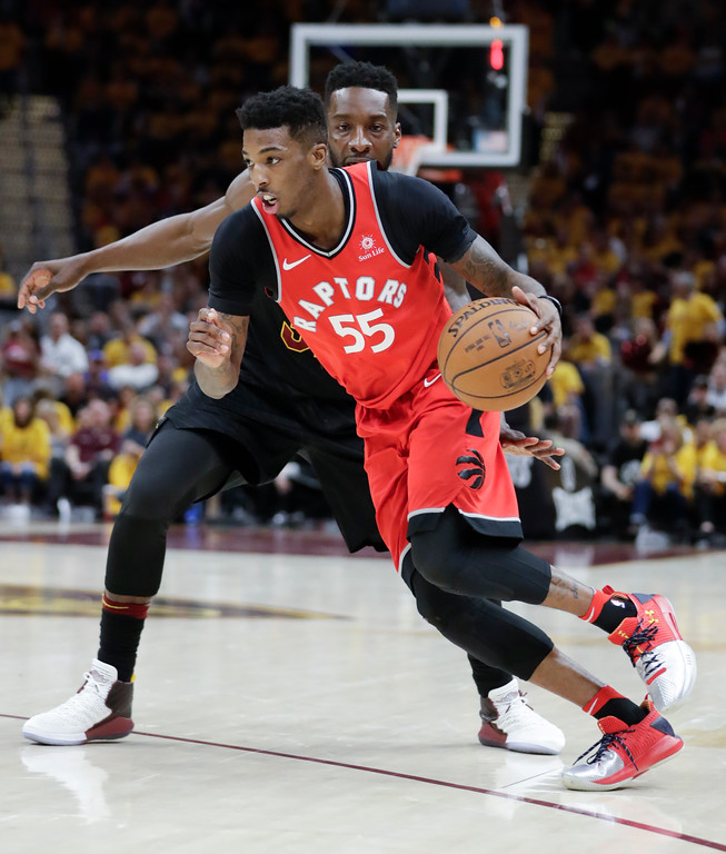 . Toronto Raptors\' Delon Wright (55) drives past Cleveland Cavaliers\' Jeff Green in the second half of Game 4 of an NBA basketball second-round playoff series, Monday, May 7, 2018, in Cleveland. The Cavaliers won 128-93. (AP Photo/Tony Dejak)
