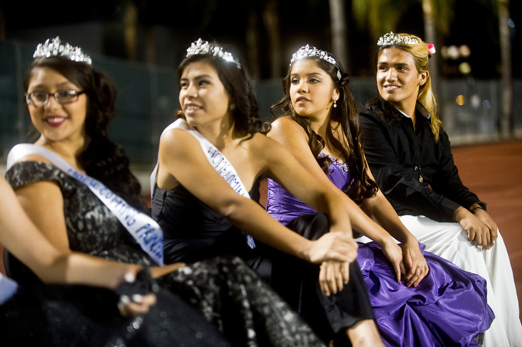 . Patrick Cordova, 16, right, a transgender senior who is running for Azusa High 2013 Homecoming Queen sits with the homecoming court during the homecoming game at Citrus College Stadium in Glendora on Friday night, Sept. 27, 2013.( Photo by Watchara Phomicinda/ San Gabriel Valley Tribune)