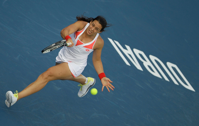 Description of . Marion Bartoli of France returns the ball to Karla Zakopalova of Czech Republic during the first day of Dubai Duty Free Tennis Championships in Dubai, United Arab Emirates, Monday, Feb. 18, 2013. (AP Photo/Kamran Jebreili)